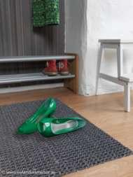 Bild på mattan Coju